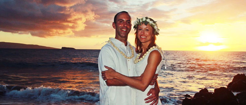 Sunset wedding on Maui beach.