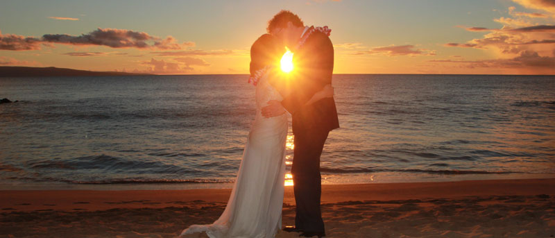 Perfect sunset wedding photograph on Maui beach.