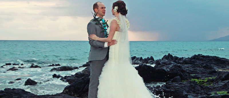 Stunning lava backdrop for Maui wedding ceremony.